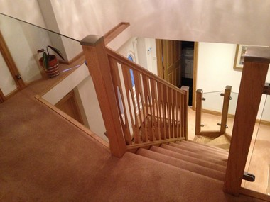 Oak open back staircase with ID spindles landing