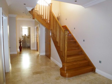 White Oak cut string staircase with chamfered balustrades
